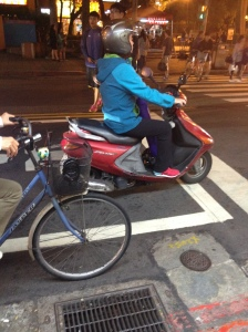 Taipei scooter rider with yoga mat